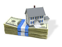 Home on a stack of cash royalty free stock images