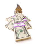 Home and Stacks of Money Isolated Royalty Free Stock Images