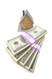 Home and Stacks of Money Isolated Stock Images