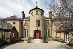 Home with stone turret. Courtyard of large home with stone turret Stock Photos
