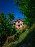 A house of stone masonary at countryside in the mountains royalty free stock photography
