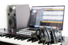 Home Studio Equipment with keyboard and headphone Royalty Free Stock Photo