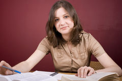 Home Study. Pretty, young woman studying in a home environment Royalty Free Stock Photography