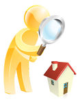 Home survey gold person. Man scrutinising a house with a magnifying glass, could be looking for a house or doing a home buyers survey Royalty Free Stock Photography