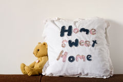 Home Sweet Home. Cute housing and real estate concept with pillow and teddy Royalty Free Stock Photo