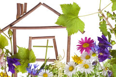 Home, sweet home... Childrens application, collage on white page  from flowers. The sweet lovely home  concept. Isolated on white Stock Image