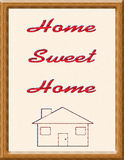 Home sweet home. Embroidery style home sweet home picture in wooden frame, isolated on white background Royalty Free Stock Photography