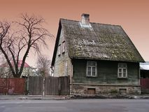 Home sweet home. Green aged house stock photography
