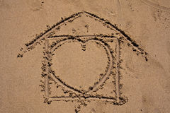 Home sweet home on the beach. Home sweet home hand draw on the sand on the beach Royalty Free Stock Photo