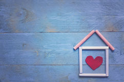 Home sweet home. On blue wooden background Stock Images