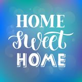 Home sweet home - Hand drawn lettering quote on abstract blue purple background with bokeh light effect for card, print or poster royalty free illustration