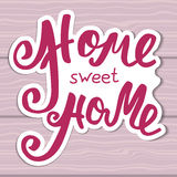 Home sweet home. Hand lettering typography poster. Calligraphic inscription, Conceptual handwritten phrase. Royalty Free Stock Image