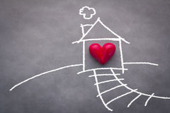 Home sweet home. House drawing with red heart on grey background Royalty Free Stock Photo