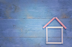 Home sweet home House made of chalk on blue wooden background Royalty Free Stock Images