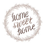 Home sweet home lettering in wreath Royalty Free Stock Photos