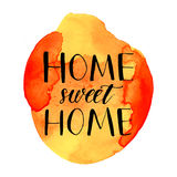 Home sweet home phrase handwritten on orange Royalty Free Stock Images