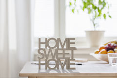 Home Sweet Home. Table top with letters making the words home sweet home Stock Photo