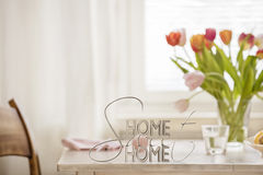 Home Sweet Home. Table top with letters making the words home sweet home Royalty Free Stock Images