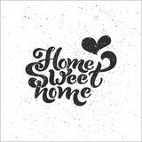 Home sweet home. Typographic vector design for greeting card, invitation card, background, lettering composition. Stock Photography