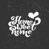 Home sweet home. Typographic vector design for greeting card, invitation card, background, lettering composition. Stock Images