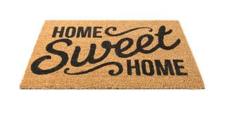 Home Sweet Home Welcome Mat Isolated on White royalty free stock photo