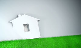 Home symbol with grass on grey background Royalty Free Stock Photo
