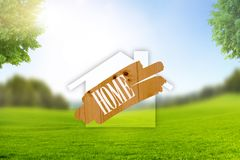 Home Symbol in Landscape with green Meadow stock images