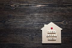 Home symbol with quote and heart shape on wooden background with. Copy space. Home sweet home Stock Photo