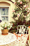 Home table in summer garden royalty free stock photo