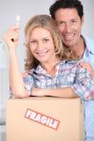 home tangent för par som är ny till Royaltyfri Foto