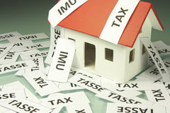 Home taxes. Model of a house with taxes Stock Photography