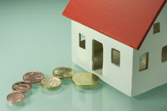 Home taxes. Model of a house with taxes Royalty Free Stock Images