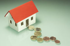Home taxes. Model of a house with taxes Stock Images