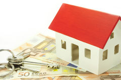 Home taxes. House of euro banknotes with keys Stock Photos