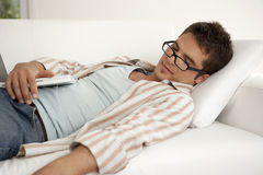 Home Tech Asleep on Sofa with Laptop Stock Images
