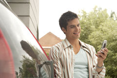 Home Tech Man with Car and Cell Stock Images