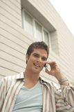 Home Tech Man with Cell by Building. Stock Photo