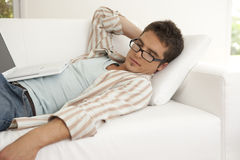 Home Tech Man Sleeping on Sofa Stock Photography