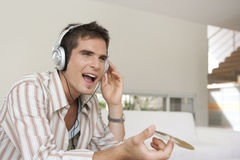 Home Tech Singing to Music Stock Photography