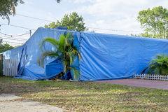 Home Tenting / Structural Fumigation. A residential home under tarps during fumigation for termites Stock Photography