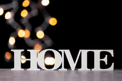 Home text against blurred lights background Stock Images