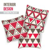 Home textile cushion throw pillows design top view. Set of 3 matching decorative pillows for interior design red and grey triangles pattern.  Pattern idea for Stock Photos