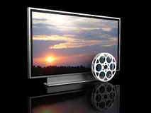 Home theater. 3d illustration of plasma tv and film reel, over black background Royalty Free Stock Image