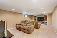 Home theater interior in soft brown color Royalty Free Stock Photos
