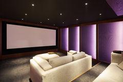 Home theater, luxury interior. Comfortable divan and big screen Royalty Free Stock Photo