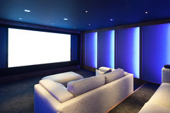 Home theater, luxury interior. Comfortable divan and big screen Royalty Free Stock Images