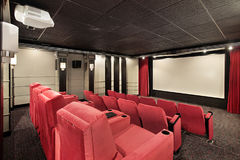 Home theater with red chairs stock images