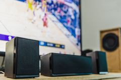 Home theater speakers and flat screen tv. Home theater speakers with a flat screen tv on the background Royalty Free Stock Photos