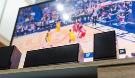 Home theater speakers and flat screen tv. Home theater speakers with a flat screen tv on the background Royalty Free Stock Photography