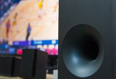 Home theater subwoofer and flat screen tv. Home theater subwoofer with a flat screen tv on the background Royalty Free Stock Images